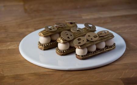 Gold chocolate éclair with salted caramel & tonka bean