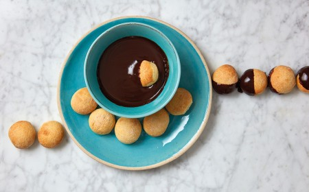 Baked dough balls with chocolate dipping sauce