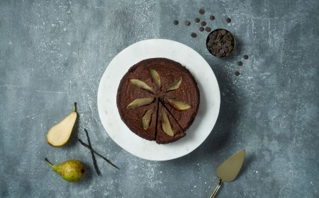 Flourless chocolate cake with poached vanilla pear